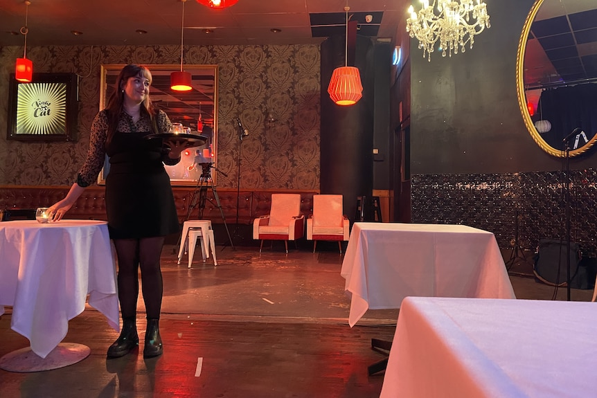 A waitress with a tray in the Nightcat jazz club