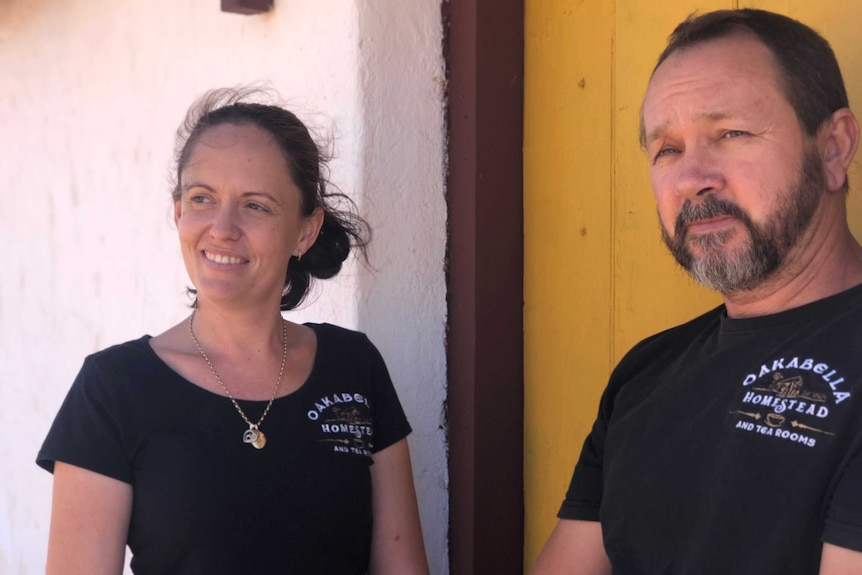 Belinda Turner and Brian Snelson outside the Oakabella Homestead, with a yellow door.