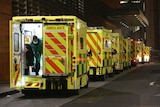 A row of ambulances are parked outside the Royal London Hospital