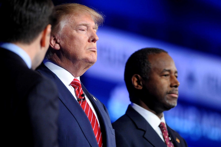 Donald Trump and Dr Ben Carson pause for a photo before the start of the debate.