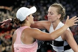 Two players hug at the net after their women's singles quarter-final at the Australian Open.