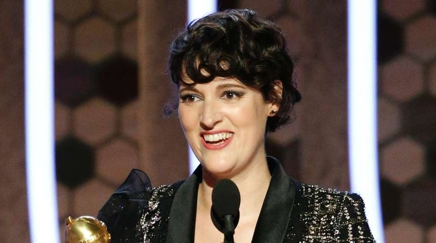 Actress Phoebe Waller-Bridge accepts the Golden Globe for best actress in a comedy series wearing a black flecked suit.