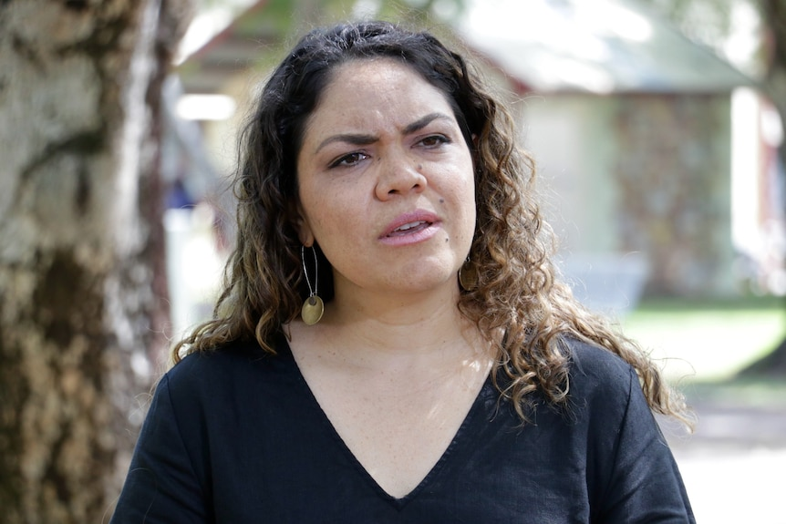 Aspiring federal politician Jacinta Price stands and looks concerned.