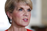 Foreign Minister Julie Bishop wears a red blazer and pearls to speak to the media.