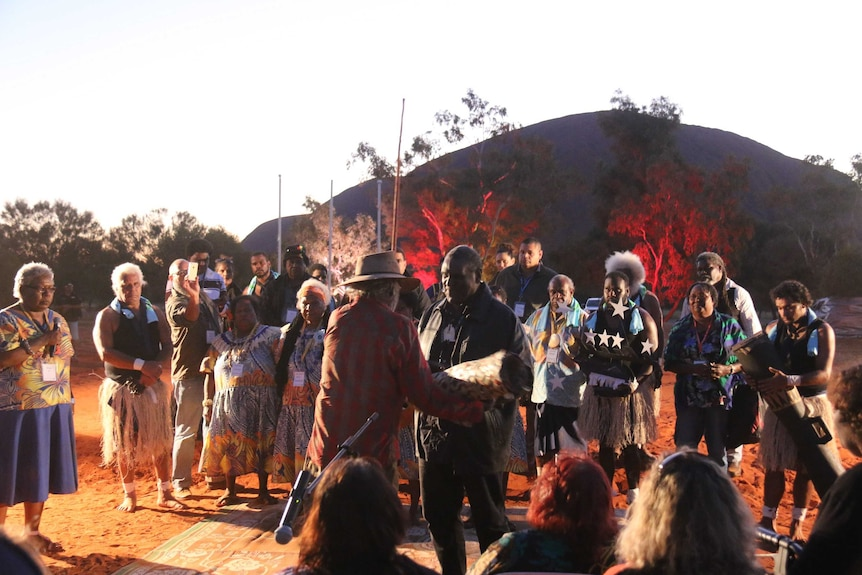 Aboriginal and Torres Strait Islanders exchange gifts at the opening ceremony of the Uluru summit.