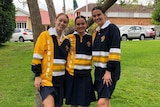 Year 12 student Abby Hewett (middle) and two friends at Mt St Michael's College in Brisbane.