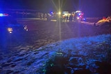 Emergency services at the cene of a four-wheel rollover on Teewah Beach about 7pm last Saturday that hospitalised two teenagers.
