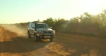 A car driving along a dirt road