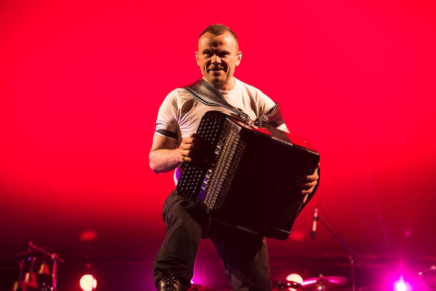 An accordion player from gypsy punk band Gogol Bordello snarls at the crowd.