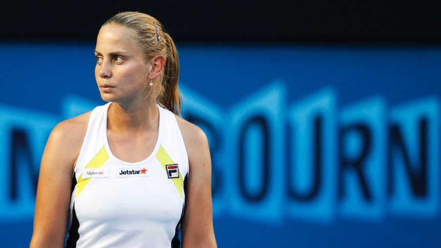 Jelena Dokic looks off to the side with a blank expression during a women's singles match.