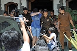 A 14-year-old Australian boy, arrested for alleged cannabis possession in Bali, leaves the District Prosecutor's office