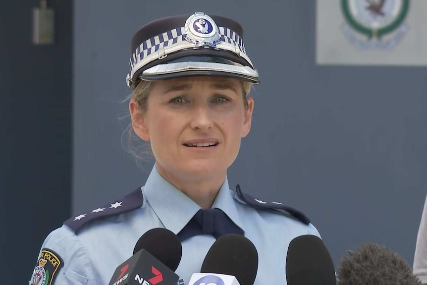 A female constable in a blue uniform