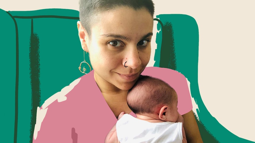 A woman smiles at the camera while holding a young baby for a story about parenting and managing PTSD
