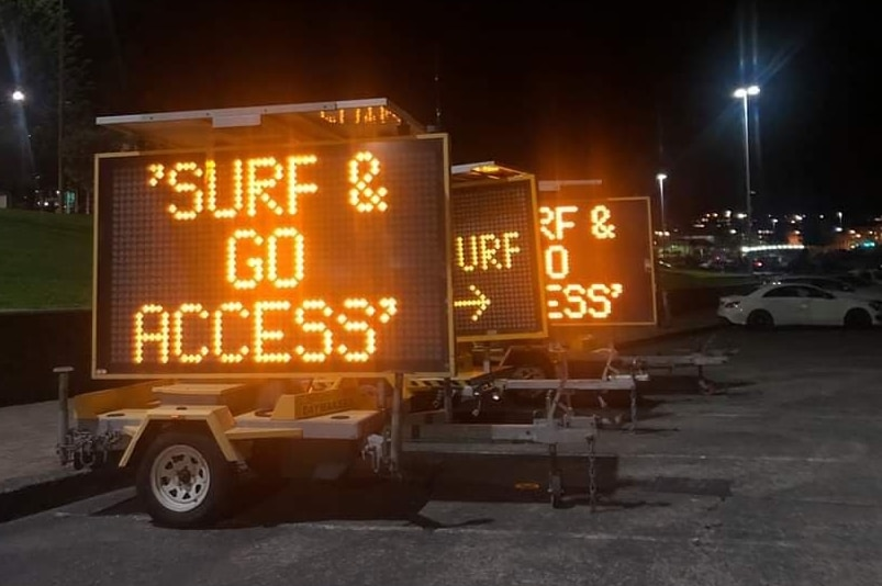 an electronic sign reading surf and go access