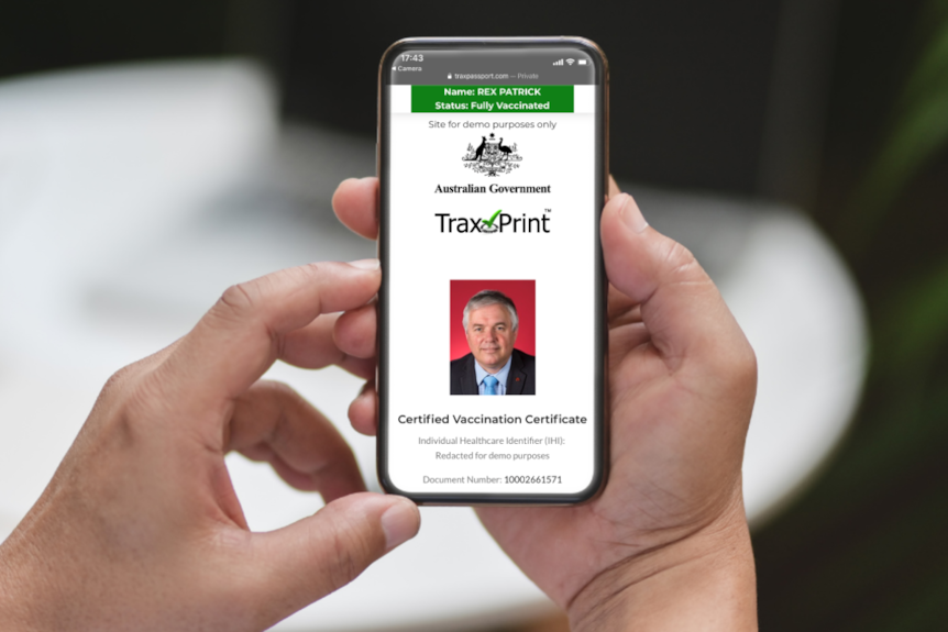 A graphic shows a mocked up 'proof of vaccination' website on a smart phone screen.
