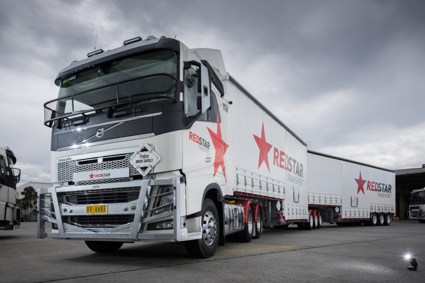 The front of a Redstar Transport truck with Redstar written on the side