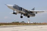Russian jets at the Hmeymim airfield in Syria prepare to target Islamic State