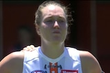 GWS Giants ruck Erin McKinnon cries before an AFLW game against Fremantle Dockers.