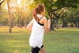 A woman runs in a park