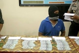 People smuggler with money