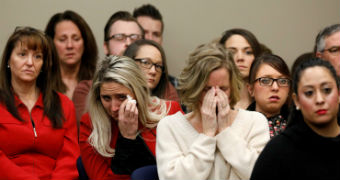 Victims and others look on as Rachael Denhollander speaks at the sentencing hearing for Larry Nassar
