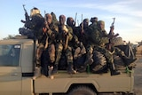 Soldiers of the Chadian army patrol the border between Nigeria and Cameroon