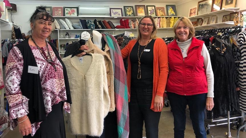 Three women standing inside a clothing shop