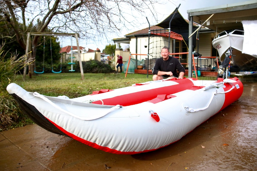 A man with an inflatable boat