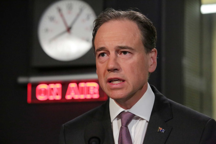 Health Minister Greg Hunt being interviewed in an ABC Radio studio.