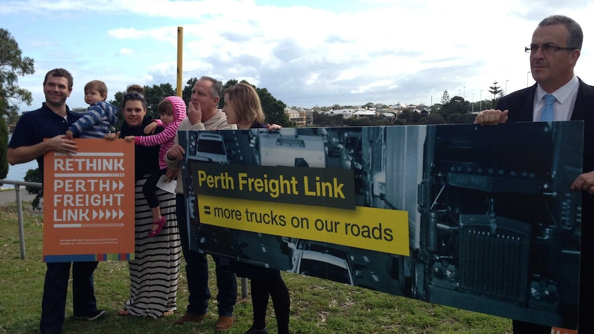 Jim O'Neill, Simone McGurk, John Hammond and Laura and Chris Omodei standing near the Canning Highway intersection with Stirling Street Bridge