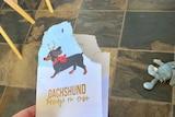 Dog chews christmas card