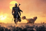 Boba Fett walks on dirt with a sun in the background.