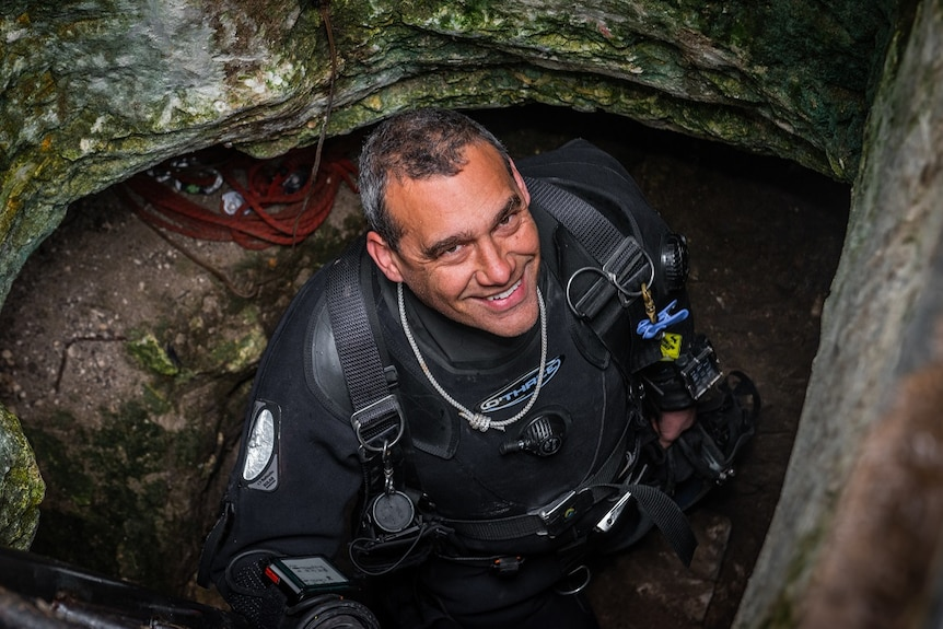 Diver Craig Challen at the entrance to Tank Cave.
