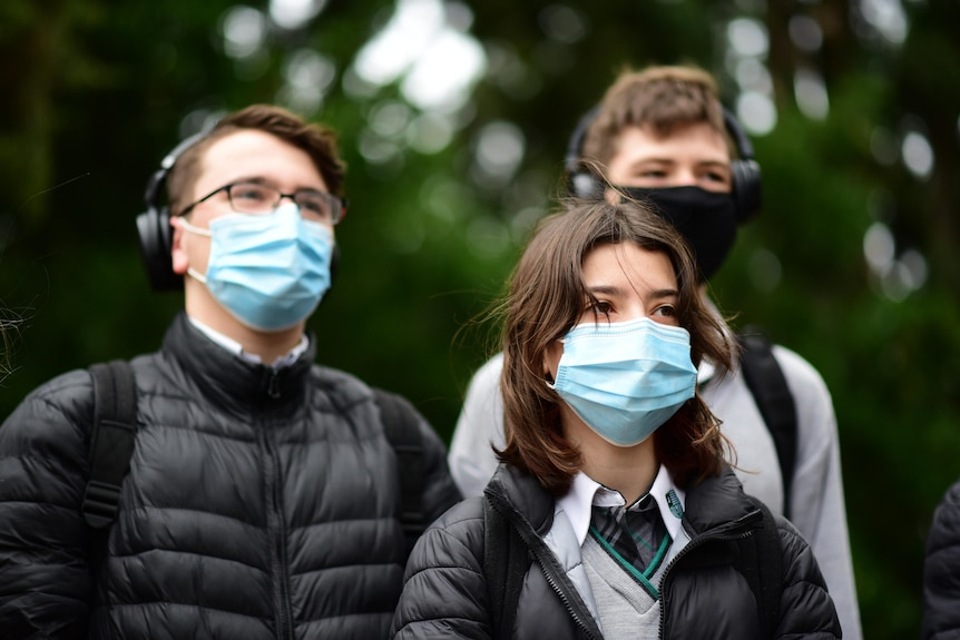 A group of students from Adelaide Botanic High School wearing face masks