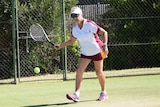 Nola Collins playing tennis in 2017