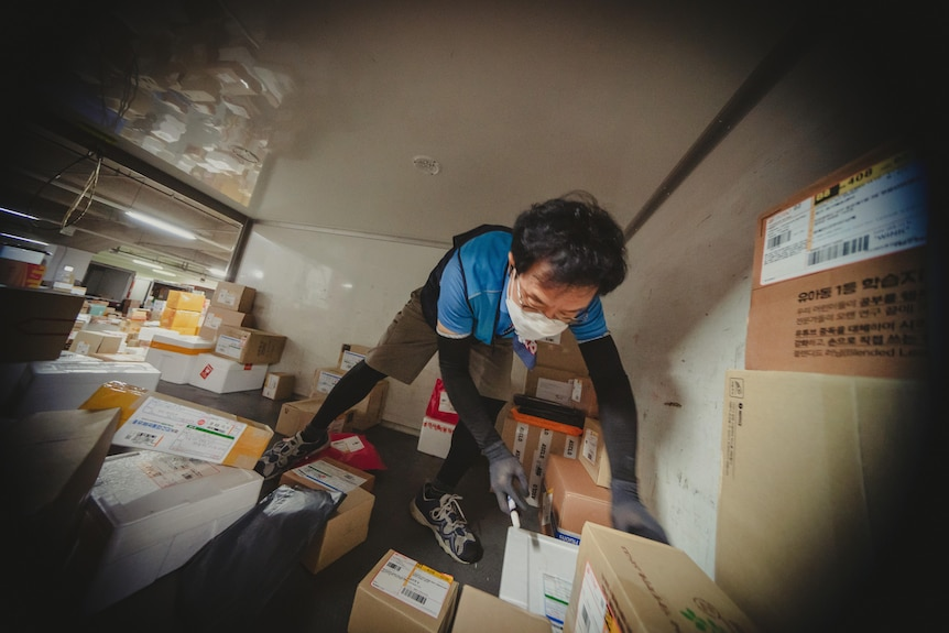 A man in the back of a delivery van.