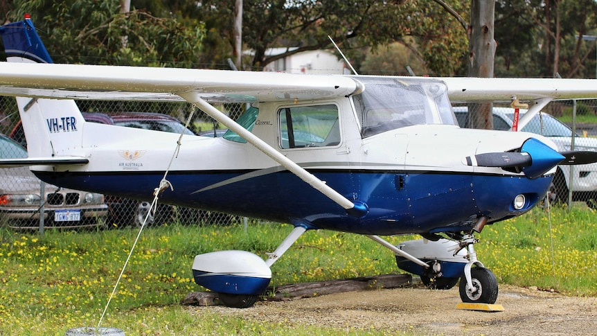 A light aircraft parked on grass
