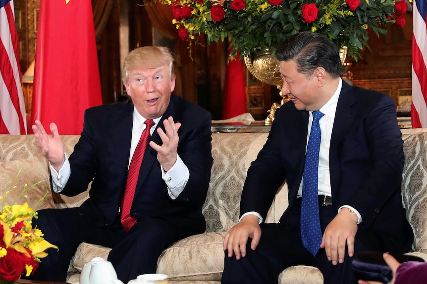 US President Donald Trump interacts with Chinese President Xi Jinping at Mar-a-Lago state in Palm Beach, Florida.