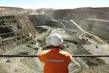 A miner looks across the Super Pit open pit gold mine at Kalgoorlie.