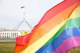Rainbow flag flying outside Australian Parliament House.