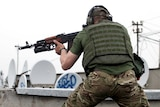 Pro-Russia militants shoot from a roof of a residential building in the Ukrainian city of Luhansk.