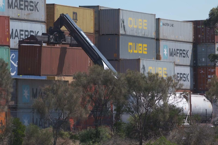 A crane lifts a shipping container at a terminal in Melbourne.