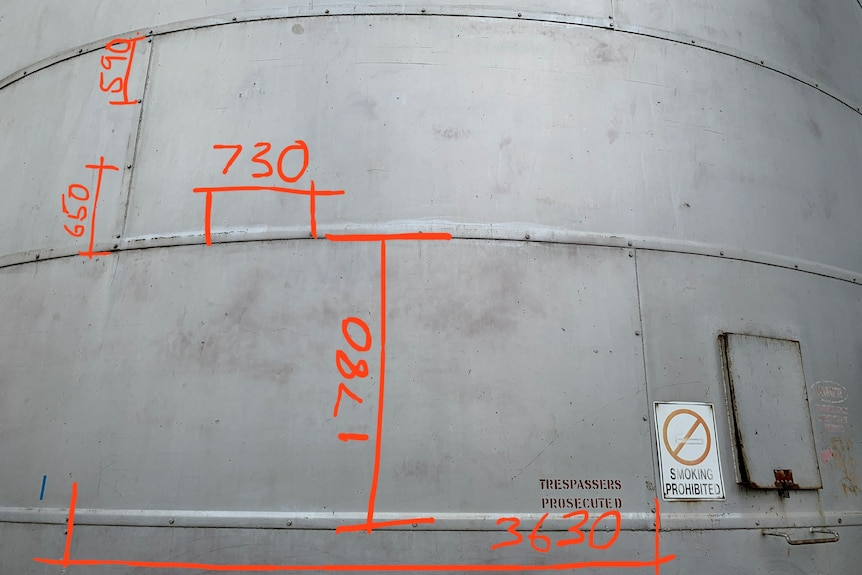 Metal silo with measurements drawn on digitally