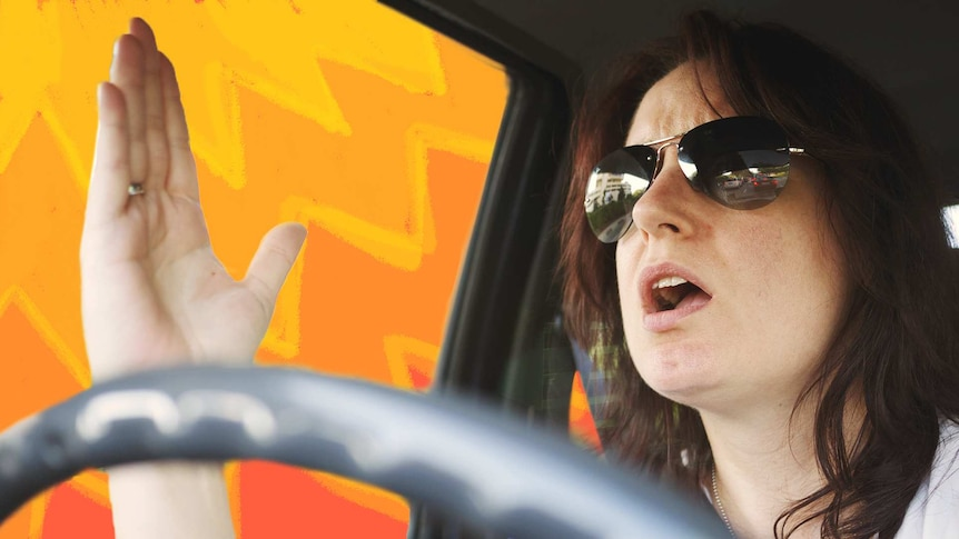 A woman wearing sunglasses while driving raises her hand with a frustrated look on her face.