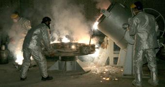 Technicians process uranium in a plant in Iran
