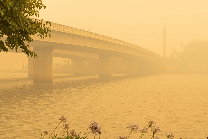 Commonwealth bridge is covered in smoke