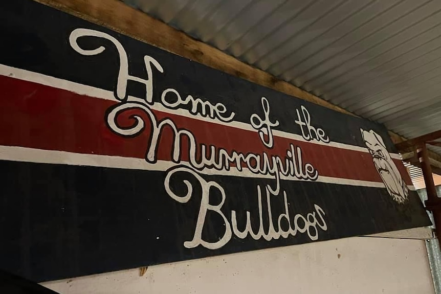 A red, blue and white banner which reads home of the Murrayville Bulldogs.