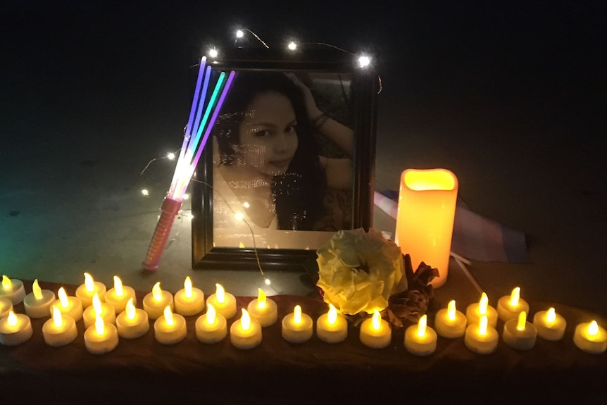 Candles and a portrait of Mhelody Bruno.