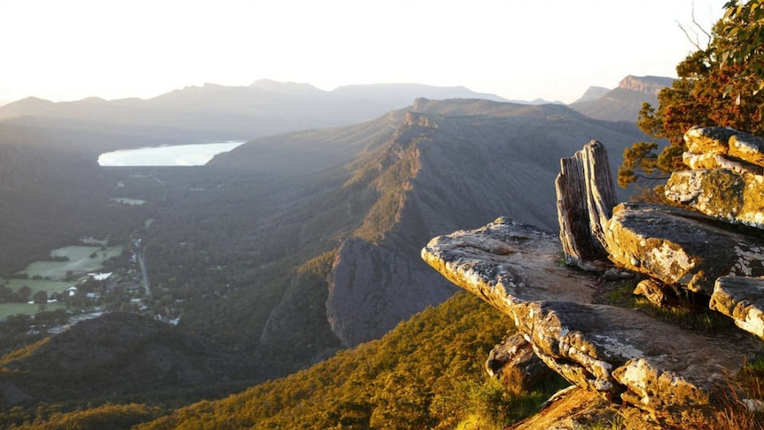 Mountains and forest is seen from a high lookout.