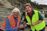 Two women at the beach during a palaeontology dig